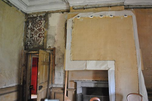 section of wallpaper from round the door, removed to be clained and put back