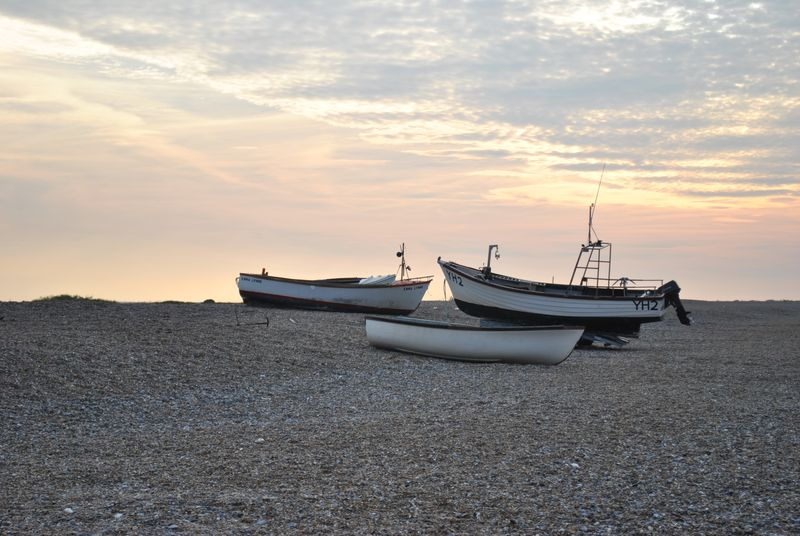 Sunset and boats on Cley beach